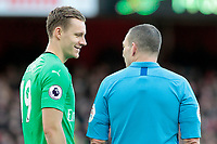 Arsenal's Bernd Leno shares a joke with Referee Kevin Friend during a break in play<br /> <br /> Photographer David Shipman/CameraSport<br /> <br /> The Premier League - Arsenal v Burnley - Saturday 22nd December 2018 - The Emirates - London<br /> <br /> World Copyright © 2018 CameraSport. All rights reserved. 43 Linden Ave. Countesthorpe. Leicester. England. LE8 5PG - Tel: +44 (0) 116 277 4147 - admin@camerasport.com - www.camerasport.com