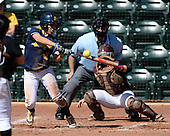 Michigan Wolverines Softball infielder Abby Ramirez (1) at bat in front of umpire Rick Tumblestone and catcher Melissa Berouty during a game against the Bethune-Cookman on February 9, 2014 at the USF Softball Stadium in Tampa, Florida.  Michigan defeated Bethune-Cookman 12-1.  (Copyright Mike Janes Photography)