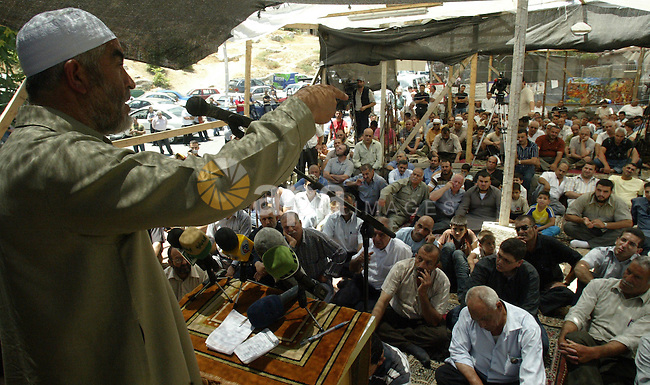Sheikh Raed Salah, head of the Arab-Israeli Islamic Movement, speaks during Friday prayers on June 19, 2009, at a newly-erected protest tent in the Israeli-annexed east Jerusalem neighborhood of Silwan, where Palestinian houses are threatened to be demolished by the city's municipality. If the municipality orders are carried out, 88 homes would be demolished, leaving 1,500 people homeless and constituting one of the largest forced evictions since Israel occupied and annexed mostly Arab east Jerusalem in the 1967 war. PHOTO by Mahfuz Abu Turk