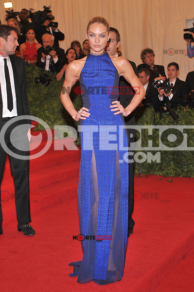 Candice Swanepoel at the 'Schiaparelli And Prada: Impossible Conversations' Costume Institute Gala at the Metropolitan Museum of Art on May 7, 2012 in New York City. ©mpi03/MediaPunch Inc.