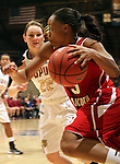 SIOUX FALLS, SD - MARCH 11:  Tempestt Wilson #3 from the University of South Dakota drives past Katie Comello #22 from IUPUI in the second half of their semifinal game Monday afternoon during the Summit League Tournament in Sioux Falls, SD. (Photo by Dave Eggen/Inertia)