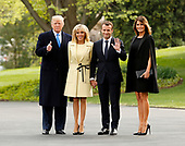 United States President Donald J. Trump and first lady Melania Trump welcome French President Emmanuel Macron and Brigitte Macron to the West Wing of the White House, in Washington, April 23, 2018<br /> Credit: Martin H. Simon / CNP