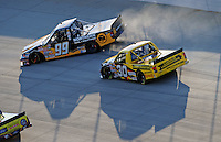 May 30, 2008; Dover, DE, USA; Nascar Craftsman Truck Series driver Erik Darnell (99) spins after contact with Todd Bodine (30) during the AAA Insurance 200 at Dover International Speedway. Mandatory Credit: Mark J. Rebilas-US PRESSWIRE.