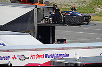 Jun. 16, 2012; Bristol, TN, USA: Crew members load up the car of NHRA pro stock driver Erica Enders following qualifying for the Thunder Valley Nationals at Bristol Dragway. Mandatory Credit: Mark J. Rebilas-