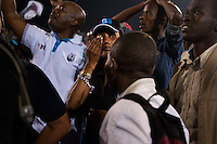 Supporter of Rwandan president Paul Kagame cries after the announcment of partial presidential election results at Amahoro stadium, Kigali, Rwanda. President Paul Kagame won 93 percent of the counted votes. August 10 2010