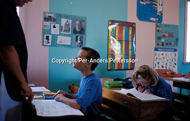 ORANIA, SOUTH AFRICA - SEPTEMBER 23: Unidentified school children listens to a strict teacher during a class in the CVO, a conservative Christian school on September 23, 2003 in Orania, in the Northern Cape province, South Africa. These children are taught in Afrikaans and they have not much contact with the outside world in South Africa. The village was founded in 1991 and bought by descendants of Hendrik Verwoerd, the architect of Apartheid. It?s run as a private town only accepting whites. About 600 Afrikaners lives in the village where they celebrate their culture and keep traditions alive. They have chosen not to live in today?s South Africa; a country ran by a black government since 1994..(Photo: Per-Anders Pettersson/ iAfrika Photos......