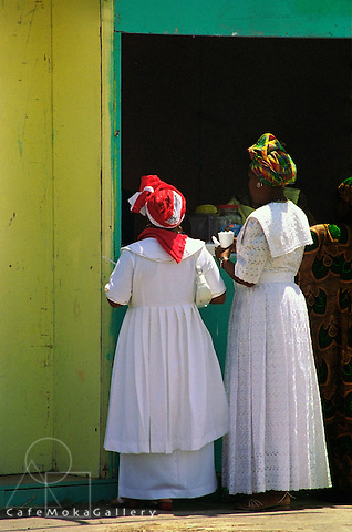 Shouter Baptist Day, Colourful Headdresses, white dresses of two women by a vendors stall