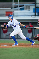 Riley King (32) of the Burlington Royals follows through on his swing against the Johnson City Cardinals at Burlington Athletic Park on August 22, 2015 in Burlington, North Carolina.  The Cardinals defeated the Royals 9-3. (Brian Westerholt/Four Seam Images)