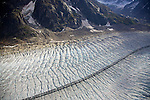 Ruth Glacier: 1 mile across, 40 miles long, 3800 feet thick.  Each little ice nob down there is like a 5 story building.