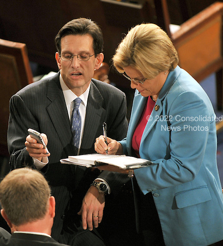 Washington, DC - March 4, 2009 -- United States House Republican Whip Eric Cantor (Republican of Virginia), left, shares some information from his Blackberry with U.S. Representative Ileana Ros-Lehtinen (Republican of Florida) on the floor of the U.S. House of Representatives as they await the arrival of Prime Minister Gordon Brown of the United Kingdom who will address a Joint Session of the U.S. Congress in the U.S. Capitol in Washington, D.C. on Wednesday, March 4, 2009..Credit: Ron Sachs / CNP