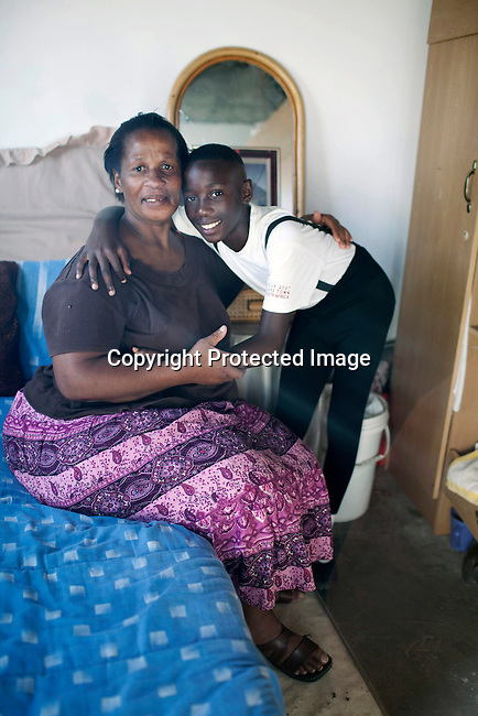CAPE TOWN, SOUTH AFRICA - MARCH 23: Sikhumbuzo Hlahleni, age 15, a student at Cape Town City Ballet's youth company with his mother in the family house on March 23, 2010 in Khayelitsha, South Africa. He trains in Cape Town every Saturday. He also trains a few days week at home in Khayelitsha, a poor township outside Cape Town. He has to change taxi three times to get to the school. (Photo by Per-Anders Pettersson)