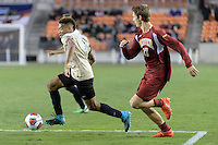 Houston, TX - Friday December 9, 2016: Jacori Hayes (8) of the Wake Forest Demon Deacons races for the goal against the Denver Pioneers at the NCAA Men's Soccer Semifinals at BBVA Compass Stadium in Houston Texas.