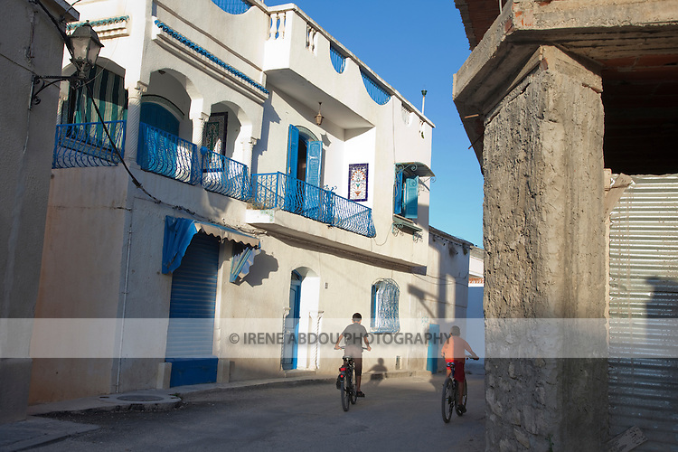 Children ride bikes down the streets of Le Kef, the unofficial capital of Western Tunisia.