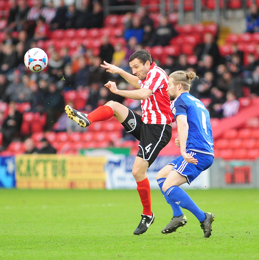 Lincoln City's Craig Stanley lifts the ball over FC Halifax Town's Kingsley James<br /> <br /> Photographer Andrew Vaughan/CameraSport<br /> <br /> Football - Vanarama National League - Lincoln City v FC Halifax Town - Saturday 26th December 2015 - Sincil Bank - Lincoln<br /> <br /> &copy; CameraSport - 43 Linden Ave. Countesthorpe. Leicester. England. LE8 5PG - Tel: +44 (0) 116 277 4147 - admin@camerasport.com - www.camerasport.com