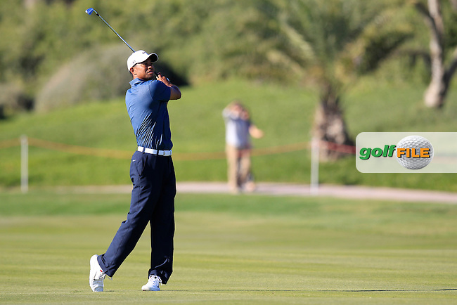 Tiger Woods (USA) plays his 2nd shot on the 14th hole during Friday's Round 2 of the Abu Dhabi HSBC Golf Championship at Abu Dhabi Golf Club, 18th January 2013 (Photo Eoin Clarke/www.golffile.ie)