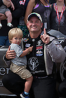 Apr. 28, 2013; Baytown, TX, USA: NHRA top fuel dragster driver Bob Vandergriff Jr celebrates with his son after winning the Spring Nationals at Royal Purple Raceway. Mandatory Credit: Mark J. Rebilas-