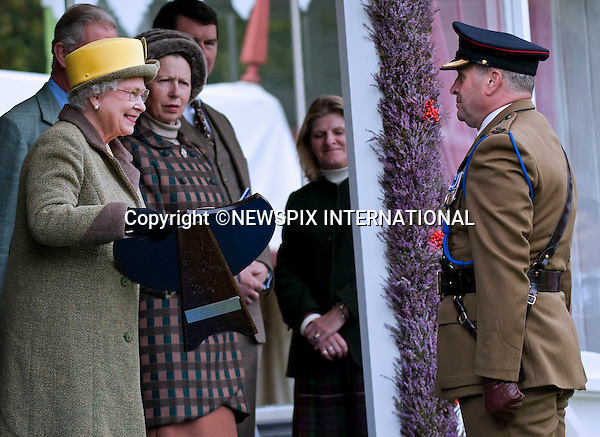 "THE QUEEN PRESENTS THE PRIZES.The Royal Family were in high sprits as they enjoyed the Braemar Gathering as well as a few jokes from Prince Charles. .attend The 2009 Braemar Gathering..The Queen who is the patron of the Braemar Royal Highland Society, attended with both Prince Charles and the Duke of Edinburgh in traditional Scottish dress, Braemar, Scotland_05/09/09.Mandatory Credit Photo: ©DIAS-NEWSPIX INTERNATIONAL..Please telephone : +441279324672 for usage fees..**ALL FEES PAYABLE TO: ""NEWSPIX INTERNATIONAL""**..IMMEDIATE CONFIRMATION OF USAGE REQUIRED:.Newspix International, 31 Chinnery Hill, Bishop's Stortford, ENGLAND CM23 3PS.Tel:+441279 324672  ; Fax: +441279656877.Mobile:  07775681153.e-mail: info@newspixinternational.co.uk"