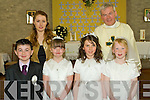 The pupils from Ballincrossig NS who made their First Holy Communion on Saturday in the Church of St Peter and Paul, Ballyduff. Pictured are Troy Baitson, Mairead Brosnan, Rebecca O'Reilly and Lauren O'Shea with teacher Evelyn O'Connell and Fr Brendan Walsh.