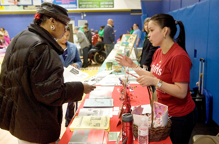 WATERBURY CT. 26 April 2014-042617SV08-From left, Bernadette Leak of Waterbury gets some information from Deisha Barriera of Girls Inc. during the eighth annual &quot;community day&quot; celebration held at Waterbury Police Activity League in Waterbury Saturday.  <br /> Steven Valenti Republican-American