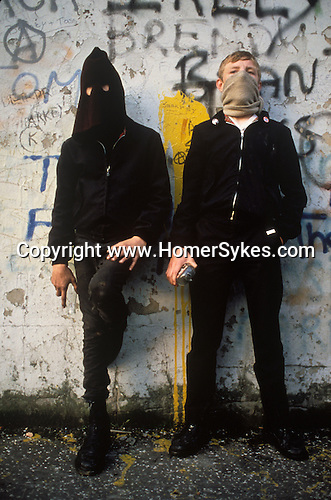 "Two young Catholic IRA ""Hoods"" with petrol bombs in the making. The Troubles, Belfast. Northern Ireland. ""Falls Road"".( The Falls Road was the centre of the Catholic urban unrest.)"