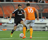 Washington D.C. - May 17, 2014:  Fabian Espindola (9) of D.C. United goes against David Horst (18) of Houston Dynamo.  D.C. United defeated  the Houston Dynamo 2-0 during a Major League Soccer match for the 2014 season at RFK Stadium.