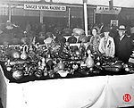 1936 - DANBURY - Fair-goers admiring a table of gourds in this 1936 photograph of the Great Danbury State Fair. Republican-American Archives