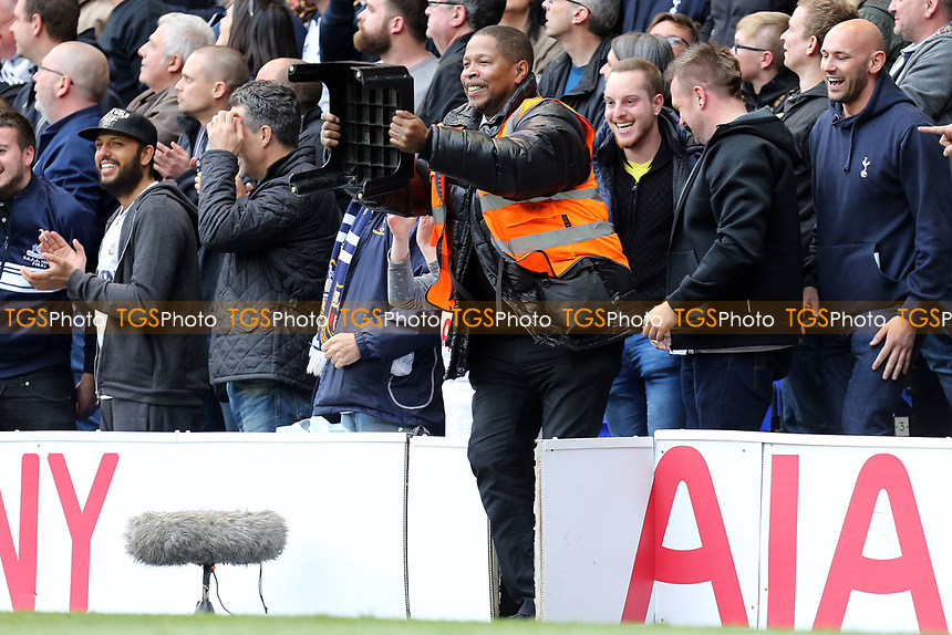 A steward dances with his seat after the opening goal during Tottenham Hotspur vs Arsenal, Premier League Football at White Hart Lane on 30th April 2017