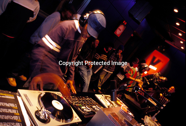 dippnig00069 Nightlife JOHANNESBURG, SOUTH AFRICA - MAY 30: Unidentified young rappers at a rap activity evening at YFM, a hip radio station located in the The Zone, a trendy shopping mall and gathering point for youth on May 30, 2002 in Rosebank a suburb in Johannesburg, South Africa. Every Wednesday night young boys come to take a chance at amateur hour, a live broadcast simultaneously live in New York for an audience of record executives where a record deal can be won. After eight years into democracy a new black middleclass and elite is growing, and they have money to spend on houses, cars and entertainment. .©Per-Anders Pettersson/ iAfrika Photos....