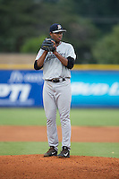 Pulaski Yankees starting pitcher Jhon Morban (56) looks to his catcher for the sign against the Burlington Royals at Burlington Athletic Park on August 6, 2015 in Burlington, North Carolina.  The Royals defeated the Yankees 1-0. (Brian Westerholt/Four Seam Images)
