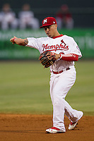 Memphis Redbirds second baseman Kolten Wong (3) makes a throw to first base against the New Orleans Zephyrs in the Pacific Coast League baseball game on June 12, 2013 at Autozone Park in Memphis, Tennessee. Memphis defeated New Orleans 9-3. (Andrew Woolley/Four Seam Images)