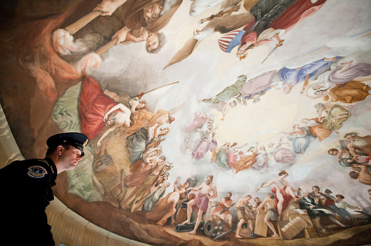 UNITED STATES - Dec 19: U.S. Capitol Hill Policemen Adam Taylor checks out the Constantino Brumidi's painting of the 'Apotheosis of Washington' on the ceiling of the U.S. Capitol's rotunda during a media tour December 19, 2013 in Washington, DC. The dome of the U.S. Capitol will be undergoing a restoration project to halt deterioration in the dome's cast iron as well as ensuring the protection of the interior of the dome and rotunda.  (Photo By Douglas Graham/CQ Roll Call)