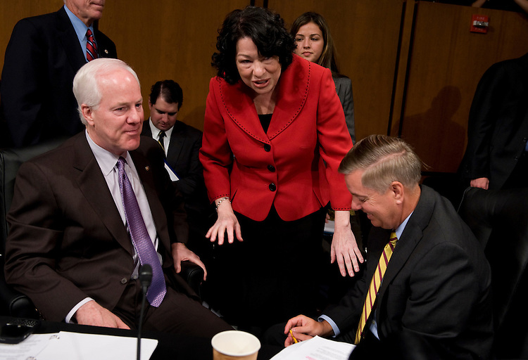 Supreme Court nominee Sonia Sotomayor talks with Sens. John Cornyn, R-Texas, left, and Lindsay Graham, R-S.C., during a break on the second day of her confirmation hearing before the Senate Judiciary Committee in 216 Hart Building, July 14, 2009
