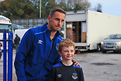 28th September 2017, Goodison Park, Liverpool, England; UEFA Europa League group stage, Everton versus Apollon Limassol; Phil Jagielka of Everton FC has his picture taken with a young fan