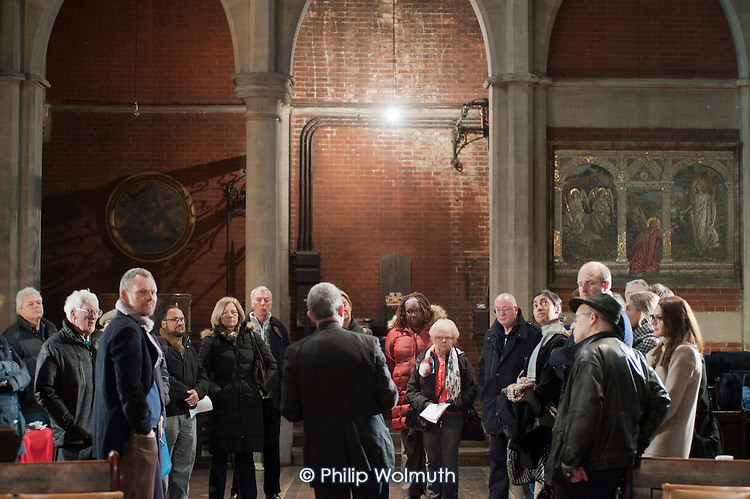 Father Henry Everett conducts a guided tour of St Mary Magdalene Church, Paddington, London.  The building, designed by architect George Edmund Street, was completed in 1878.
