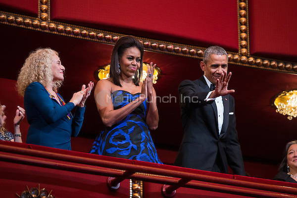 United States President Barack Obama and First Lady Michelle Obama attend the Kennedy Center Honors at the Kennedy Center in Washington, DC, USA, 06 December 2015. The 2015 Kennedy Center honorees are: singer-songwriter Carole King, filmmaker George Lucas, actress and singer Rita Moreno, conductor Seiji Ozawa, and actress and Broadway star Cicely Tyson.  Carole King is pictured at left.<br /> Credit: Jim LoScalzo / Pool via CNP/MediaPunch