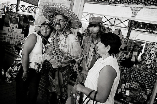 Tombstone, Arizona.USA.October 21, 2006..In this small historical town, where the shoot out at the OK Coral took place, residence dress up in old period costumes at least once a month and stroll the streets and bars as in the old days. Theatrical shoot-outs take place on the main street all day long. A Mexican bandito walks the town and posses for a few photos...It is the town where the Minutemen, who unofficially patrol the border, originates from. The civilian patrols stay along the border and encourage illegal immigrants to sit until the official border patrol arrives to return them to Mexico. Most of Minutemen carry guns for their own protection. ..