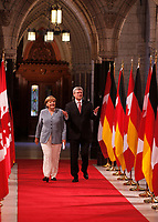 August 15 2012  File Photo -<br /> German Chancellor Angela Merkel meeting Canadian Prime Minister Steven Harper at the House of Commons in Ottawa.<br /> <br /> Photo (c) Raffi Kirdi - Images Distribution