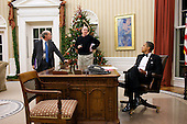 Following the Kennedy Center Honors, United States President Barack Obama receives a briefing from Jeff Bader, Senior Director for Asian Affairs, left, and National Security Advisor Tom Donilon, right, before placing a telephone call to President Hu Jintao of China in the Oval Office, December 5, 2010. .Mandatory Credit: Pete Souza - White House via CNP