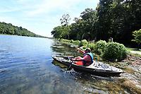 NWA Democrat-Gazette/J.T. WAMPLER Omar Ortega, 12, or Rogers launches his kayak Thursday July 11, 2019 at Lake Atalanta in Rogers. Ortega comes to the lake often to kayak and fish.