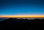 View from the rim of the crater of Mt. Haleakala at the Visitor Center (elevation 10,000 feet), 20 minutes before sunrise.