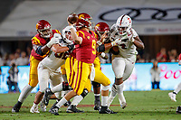 LOS ANGELES, CA - SEPTEMBER 7: USC Trojans quarterback Kedon Slovis #9 makes a pass while pursued by Stanford Cardinal defensive end Thomas Booker #34 during a game between USC and Stanford Football at Los Angeles Memorial Coliseum on September 7, 2019 in Los Angeles, California.