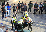 "Israeli forensic police carry the body of a man who attempted to carry out a knife attack at the Damascus Gate at the entrance of the Old City in east Jerusalem on October 14, 2015. Israeli police said a ""terrorist"" attempted to stab a security guard at an entrance to Jerusalem's Old City but was shot before harming anyone, the latest in a wave of such incidents. Photo by Mahfouz Abu Turk"