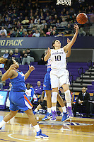 SEATTLE, WA - DECEMBER 18: Washington's #10 Kelsey Plum gets fouled as she drives to the basket against Savannah State.  Washington won 87-36 over Savannah State at Alaska Airlines Arena in Seattle, WA.