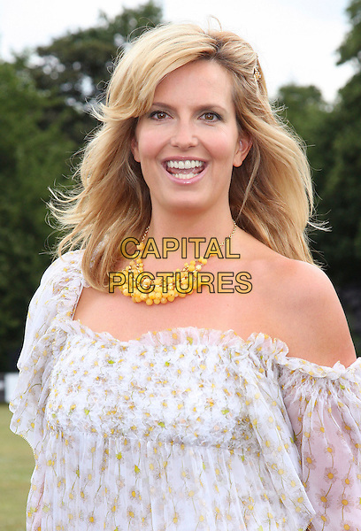 PENNY LANCASTER STEWART .Duke Of Essex Polo Trophy at Gaynes Park, Epping, Essex, England, UK,.July 4th 2009..half length white sheer puff sleeve off the shoulder dress blouson print necklace yellow beads .CAP/ROS.©Steve Ross/Capital Pictures