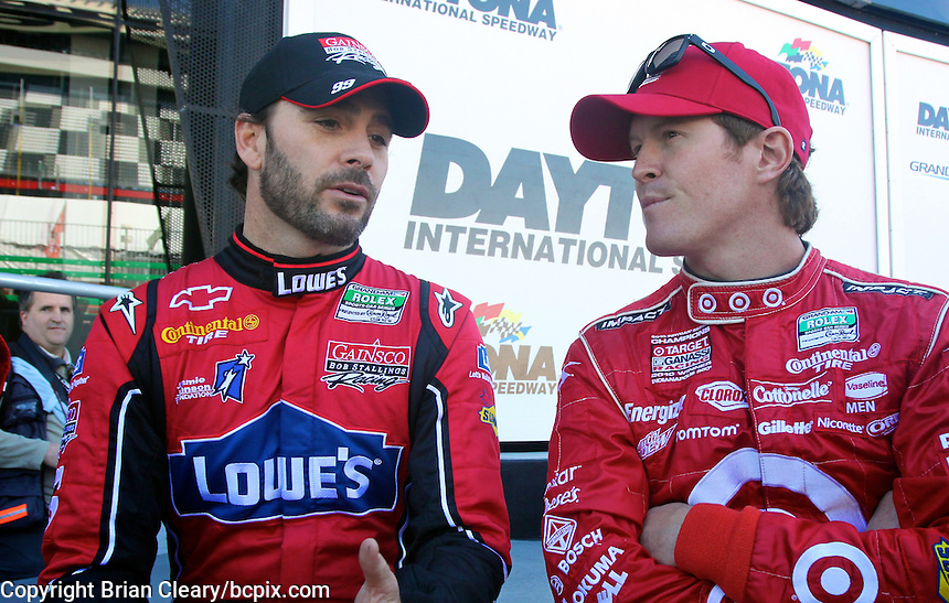30 January 2011: Jimmie Johnson, left, Scott Dixon,  Rolex 24 at Daytona, Daytona International Speedway, Daytona Beach, FL (Photo by Brian Cleary/www.bcpix.com)