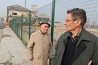 - Piero Ferraris, worker of the plant in Casale Monferrato and Henri Desgrange, employee of Eternit France, poisoned by asbestos, on the former site of the factory now dimantled<br /> <br /> - Piero Ferraris, operaio dello stabilimento di Casale Monferrato e Henri Desgrange, dipendente dell'Eternit Francia, intossicati dall'amianto, sul luogo dove sorgeva lo stabilimento, oggi smantellato