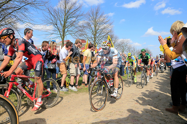 The peloton including German Champion Andre Greipel (GER) Lotto-Soudal tackle Sector 10 Mons-en-Pevele during the 113th edition of the Paris-Roubaix 2015 cycle race held over the cobbled roads of Northern France. 12th April 2015.<br /> Photo: Eoin Clarke www.newsfile.ie