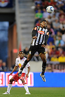 Alex Sandro (3) of Santos FC heads the ball during the first half of a friendly between Santos FC and the New York Red Bulls at Red Bull Arena in Harrison, NJ, on March 20, 2010. The Red Bulls defeated Santos FC 3-1.