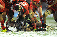 Niall Morris of Leicester Tigers is tackled by Yannick Nyanga of Stade Toulousain during the Heineken Cup 6th round match between Leicester Tigers and Stade Toulousain at Welford Road on Sunday 20th January 2013 (Photo by Rob Munro).