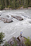 Gordon Congdon surveys Log Jam Rapids #1 on the Gataga River. Muskwa Kechika Management Area, B.C.